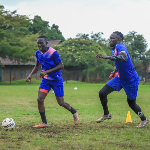 Andama Junior and Toha Rashid scramble for the ball in a training at Bishop's play ground
